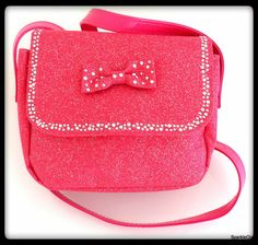 Girls love cute sparkly purses and this one is sure to please your little fashionista! The canvas type material has glitter pattern over all. The top flap is trimmed with sparkly rhinestones. She can throw it over her shoulder for easy carrying.