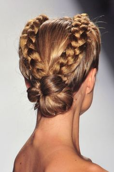 Glossy twin braids offer a high-drama looked that can be dressed up or down depending on your mood.
