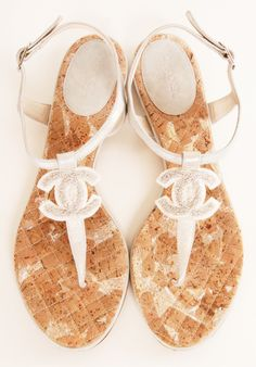 Chanel silver logo sandals- Lining is lambskin, insole made of special material called copy soft wood, rubber outsole, flat heel. Mesh material CC logo. These adorable sandals are very casual but still so chic! The silver color goes with almost everything.