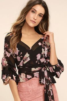 Your adoration for the Blooming Love Blush Pink and Black Floral Print Wrap Top will only grow and grow! A romantic pink and beige floral print covers sheer black chiffon over a wrapping bodice with long tying sash. Ruffled three-quarter sleeves have fitted cuffs.