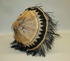 Parasol Date: 1860s Culture: American or European Medium: silk, straw, raffia, wood, silver