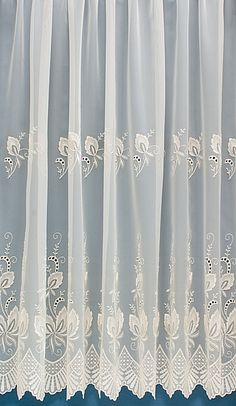 Winfarthing is a very delicately woven voile, adorned with beautiful satin embroidery. The scalloped edge adds a feminine touch to this exquisite deign.