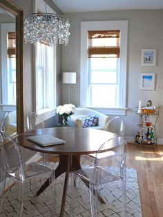 Eclectic Dining Room by Megan Blake Design Modern table with Louis Ghost chairs. Perfect for small spaces but appropriate anywhere, clear chairs like the . Acrylic Dining Chairs, Acrylic Chair, Acrylic Furniture, Small Dining, Round Dining Table, Dining Area, Round Tables, Dining Corner, Dinning Set