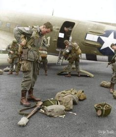 Brigadier General James Gavin, commander of the 82nd American Airborne, checking his equipment before boarding the C-47 to make the drop into Holland for Operation Market Garden, 17 September 1944.