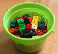 Preschool/Kindergarten Active Math Game - set up bucket with linking cubes.  Show student a number card, have them run across room to build a tower with that many number cubes and run back to you with their tower.
