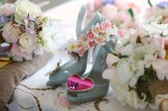 Vivienne Westwood 'heart' wedding shoes in pink and grey from a vintage handmade, countryside wedding. Read the full story here:  the-wedding-of-sally-louie-nicholson-and-chris-slater-1