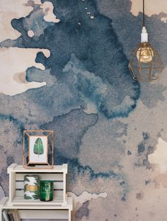 Watercolor wonders. We're loving this dusty pink and navy wallpaper design! Compliment with copper accessories for instant glam in living room spaces.