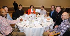 """From left to right at the Worldstrides table: Jimmy Majors, Will Eubanks, Taylor Gagnon, Julia Given, Brian Rimel, Rusty Speidel, Timothy Robinson, and Greg Bures,  """"Jimmy Miller's Bracket Breakfast for Piedmont CASA"""" on March 14, 2016. Image by Jennifer Byrne Photography."""