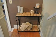 Aquarium stand repurposed into an entry table using pallets!!