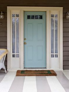 """Blogger Ellen Mallernee Barnes (blackandwhiteandlovedallover.com) got so inspired while she was painting her front door blue—that's Benjamin Moore's Wythe Blue, its paint color of the year for 2012—that she decided to go all out with porch stripes. Those colors are from Sherwin-Williams: Perfect Greige and Antique Ivory. """"It turned out so fun and bright,"""" Barnes says. """"I love pulling into my driveway now."""""""
