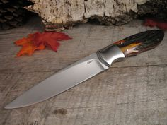 "Eddie T. Elsmore - Amber Stag Presentation Hog Hunter - Fort Henry Custom KnivesFort Henry Custom Knives Handle Material: Aged Amber Sambar Stag Blade Steel: ATS-34 Blade Length: 5 1/4"" OAL: 10 1/8"""