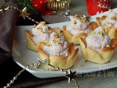 Cestini con crema di mortadella e pistacchio, deliziosi cestini di pasta brisè coni mousse di mortadella e granella di pistacchio, facile e veloci da fare