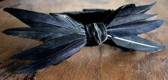 How insane is this bow tie!!!! Handmade black satin and feathers by Lord Wallington.