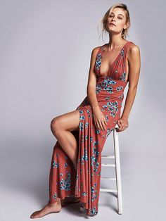 Other Days Maxi | Floral printed maxi dress featuring a plunging V-neckline with brass colored button closures down the front. Strappy back with an adjustable fit. American made.