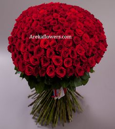 ENCHANTED ROSES Bouquet of premium 60 stem red roses – Wrapped in cellophane sheet packing. Free message card