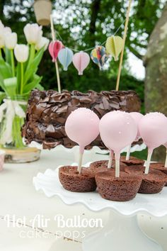Hot air balloon cake pops- cake pops stuck in brownie bites for the basket. Super easy and cute!