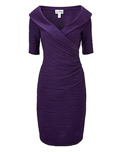 Joseph Ribkoff Cascade Jersey Dress, soft ripple-pleated stretch jersey in a dazzling violet hue, this form-fitting mock wrap dress shapes an enviable silhouette. Pull-on style, Dupioni portrait collar with half-length sleeves. Length 34in/87cm.
