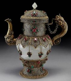 Iced teapot made of rock crystal, trimmed with gilt filigree with emeralds and rubies, Nachalo