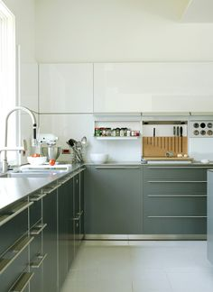 Modern kitchen cabinetry - gray lower cabinets, white upper cabinets.  Cute small kitchen. http://cococozy.com