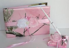 This sporty guest book and pen set is perfect for the modern outdoorsy bride. It is made with Soft Pink Realtree AP Satin Camo print and soft pink and white shabby chic flowers, pearl brooch and match Pink Camo Wedding, Pink Camo Baby, Camo Wedding Dresses, Camo Wedding Cakes, Camouflage Wedding, Cowgirl Wedding, Pink Camouflage, Dream Wedding, Cupcake Wedding