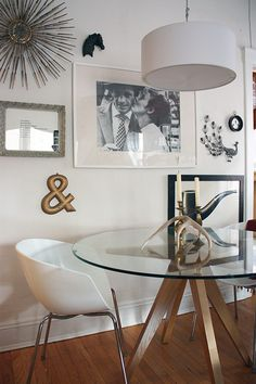 love this room. the table & lighting, the sweet b print and white everywhere. clean and styled, not cluttered.