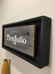 Hand Made Hand Painted Rustic Don Julio Tequila signs. All materials are from reclaimed pallet wood Offered in 2 different colors: •Oak Barrel style •Weathered Grey Backing box is offered in stained in Red Mahogany OR Weathered Black **All come with multi-color Battery operated lights WITH