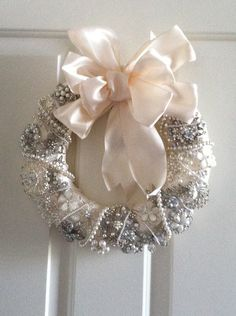 I used a wreath that I saw on Pinterest as the inspiration for this. I used rhinestone brooches (cut the backs off and hot glued) and old pearl necklaces bought really cheaply on eBay. Followed a Youtube video to tie the bow! Easy peasy.