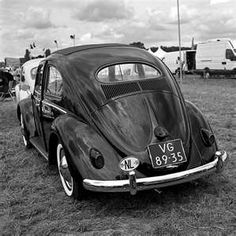 my first car: 1956 VW bug.with small rear window, fly wheel for an accelerator pedal and no working heater in the middle of winter in Wisconsin.but I could work on the engine! Vw Camper, Campers, First Car, Street Rods, Vw Beetles, Rear Window, Black Is Beautiful, Travel Posters, My Favorite Color