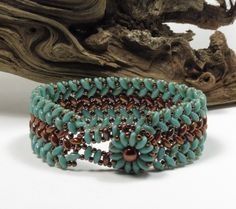 SUPERDUO HERRINGBONE BRACELET - Turquoise Picasso - Bronze Luster Opaque Red - SuperDuo Beaded Flower Button - Toho Seed Beads by CinfulBeadCreations on Etsy