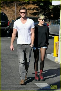 miley cyrus wearing red dr. martens.