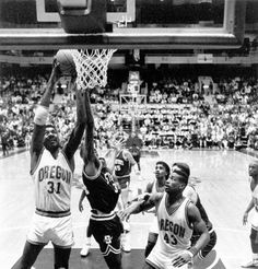 Black and white photo of University of Oregon basketball player Richard Lucas (#31) taking the ball to the basket while teammate Eric Dunn (#43) looks on during a game against Stanford played at McArthur Court on February 1, 1990 and won by the Ducks 62-61. ©University of Oregon Libraries - Special Collections and University Archives Basketball History, Basketball Players, University Of Oregon, February 1, Libraries, Ducks, Collections, Black And White