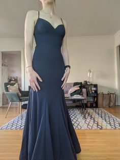 This dress is beautiful! I got a custom size and it is still a tiny bit large in the bust, but nothing a stick-on bra can't fix! I'm 5'10' and it was great to get enough length that I can wear it with heels or flats! Very pretty color (dark Navy), and nice material that has stretch but still holds it's shape. Overall great!!