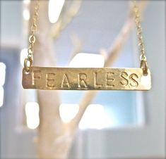 At the top of my wish list!! Swoon!    Gold FEARLESS Necklace  Long Horizontal Bar by onelifejewelry