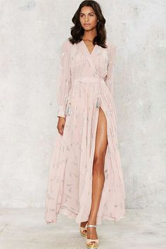 You already know how much we appreciate a good wrap dress, and we really love the effortless appeal of this light-pink one. Nastygal Anjelica Maxi Dress, $168, available at Nastygal.  #refinery29 http://www.refinery29.com/maxi-dresses#slide-6