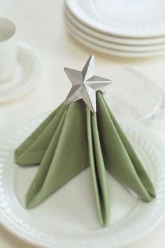 I appreciate the simplicity of this napkin fold for the Christmas table, not fussy but obviously some effort went into it.