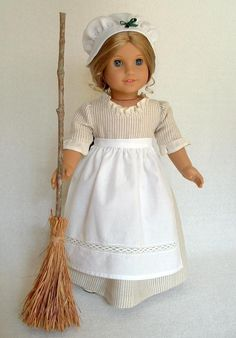 Handcrafted Dress Apron Cap and Broom - Cottonwood's booth - $28.00 The dress is handcrafted from a textured fabric which has a linen look with flecks of fibers throughout; and is trimmed with a new fabric ruffle at the neck and sleeves. White cap is a very fine cotton fabric. Apron is a white cotton fabric with a lovely insert detail.  This brooms branchis from a Pecan Tree and wild grass was cut from field.