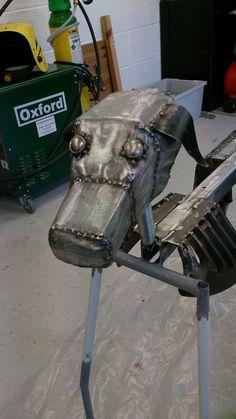 Metal dog sculpture
