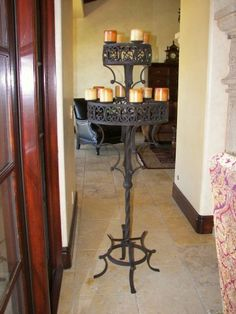Custom iron candelabra light, electrical wiring for light bulb in hollow wax candles