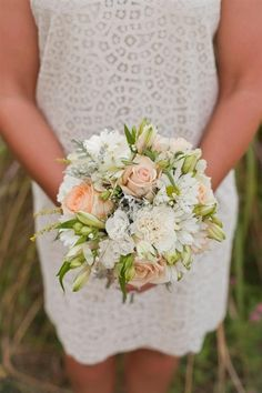 An adorable bouquet with apricot roses.