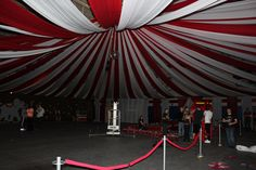 Transform your gym with a circus tent for prom.  Hang red and white plastic table cloths (you can buy from party places) from the center (by the disco ball) and tape on the outside of the gym.