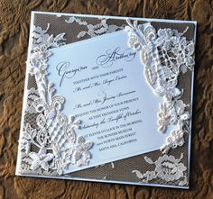 Gold wedding invitation with romantic lace