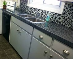 DIY Countertops - Many different products & attempts and a winner! Krylon Make It Stone and Envirotex epoxy resin.