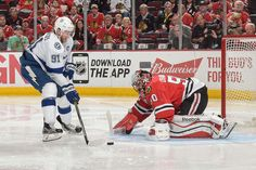 CHICAGO, IL - JUNE 15: Steven Stamkos #91 of the Tampa Bay Lightning takes the puck toward goalie Corey Crawford #50 of the Chicago Blackhawks during Game Six of the 2015 NHL Stanley Cup Final at the United Center on June 15, 2015 in Chicago, Illinois. (Photo by Bill Smith/NHLI via Getty Images)