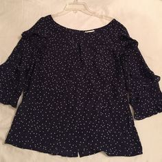 NWT Anthropologie navy and polka dot top NWT Anthropologie navy and polka dot top with buttons down the back and ruffle detail to the 3/4 sleeves. Anthropologie Tops Blouses