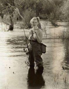 vintage - woman in waders - fishing - bette davis?
