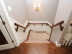 This wall color would lead nicely from the entryway, through and hall and up the stairs.  Coordinates with the white molding and dark hardwoods.