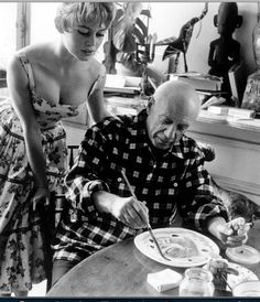 Brigitte Bardot watches Pablo Picasso at work in his studio in Vallauris during the 1956 Cannes Film Festival