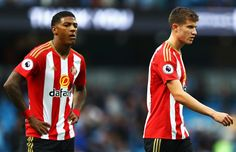 Jeremain Lens (L) of Sunderland and (R) Paddy McNair of Sunderland are dejected after the final whistle during the Premier League match between Manchester City and Sunderland at Etihad Stadium on August 13, 2016 in Manchester, England.