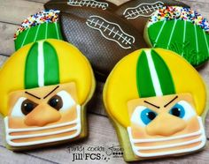 Jill FCS : football theme cookies. Face w/helmet, stadium, football.