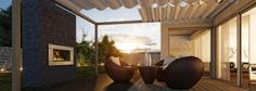 Outdoor deck with roundish furniture and Escea EW5000 wood fire